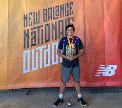 Noah Belmnahia with National hammer throw medal