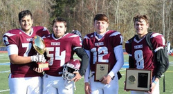 Football players with Sectional championship triphies